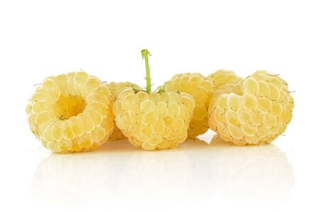 Group of five whole fresh golden hymalayan raspberry isolated on white background