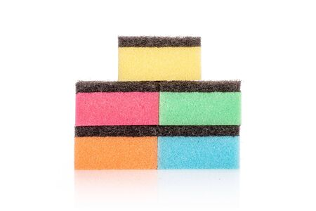 Group of five whole colourful cleaning kitchen sponge isolated on white background