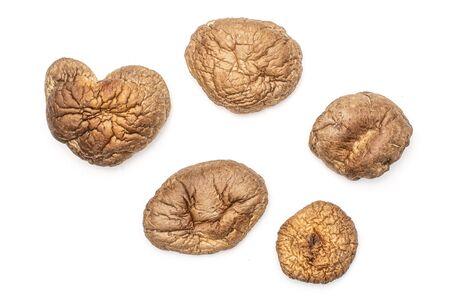 Group of five whole dry mushroom shiitake flatlay isolated on white background Reklamní fotografie