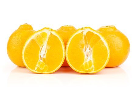 Group of three whole two halves of fresh orange tangelo minneola isolated on white background Banque d'images - 129474120