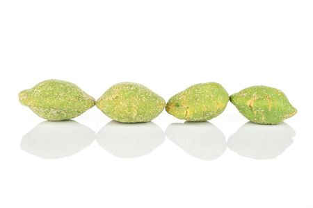 Group of four whole spicy green wasabi peanut isolated on white background Stockfoto