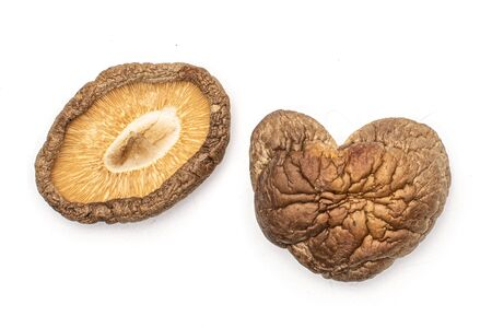 Group of two whole dry mushroom shiitake heart shape flatlay isolated on white background Reklamní fotografie