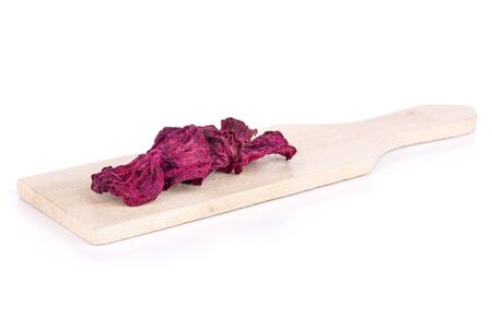 Group of five slices of dried red beetroot on small wooden cutting board isolated on white background Stock fotó