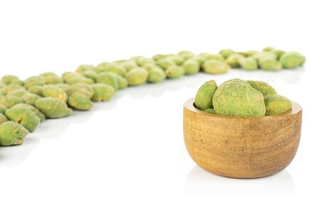 Lot of whole spicy green wasabi peanut in tiny wooden bowl isolated on white background Stockfoto