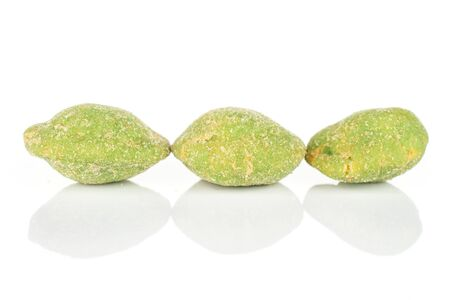Group of three whole spicy green wasabi peanut isolated on white background Stockfoto