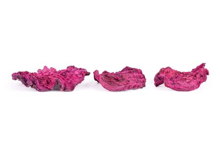 Group of three slices of dried red beetroot isolated on white background Archivio Fotografico