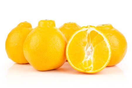 Group of four whole one half of fresh orange tangelo minneola isolated on white background Banque d'images - 129475716