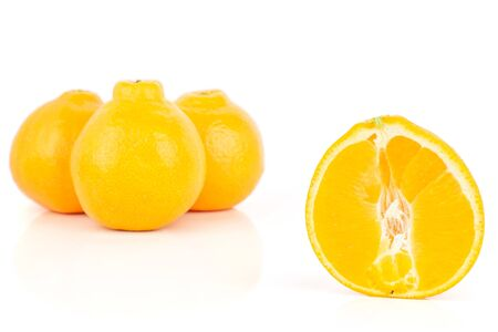 Group of three whole one half of fresh orange tangelo minneola isolated on white background Banque d'images - 129475757