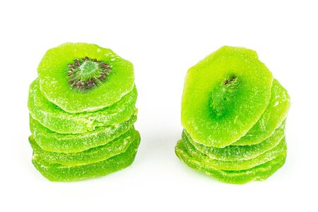 Group of ten slices of sweet green candied kiwifruit isolated on white background Banco de Imagens