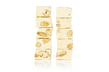 Lot of whole sweet white nougat in two columns isolated on white background 写真素材