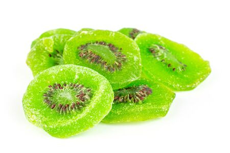 Lot of slices of sweet green candied kiwifruit isolated on white background Banco de Imagens
