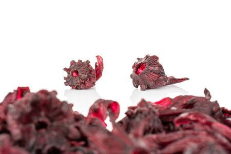 Lot of whole sweet red candied hibiscus two are aside isolated on white background