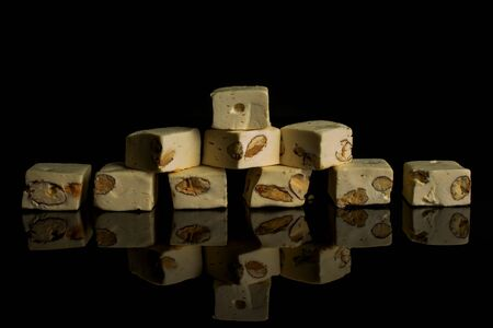 Group of ten whole sweet white nougat isolated on black glass