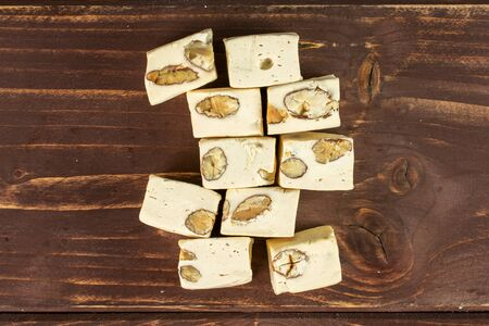 Lot of whole sweet white nougat flatlay on brown wood