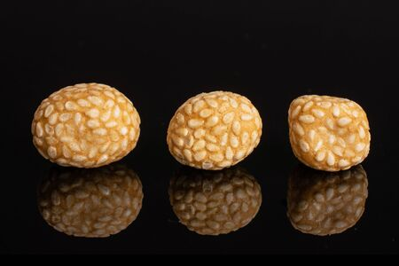 Group of three whole sesame rice japan assortment isolated on black glass 写真素材
