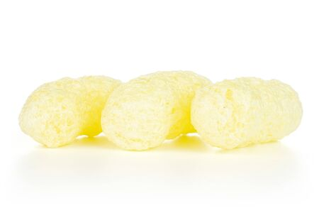 Group of three whole salted yellow corn puff isolated on white background