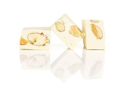 Group of three whole sweet white nougat isolated on white background