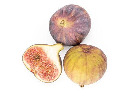 Group of two whole one half of fresh fig fruit flatlay isolated on white background