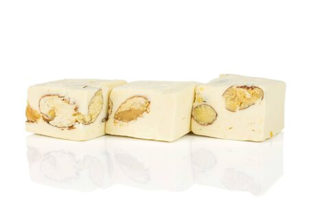 Group of three whole sweet white nougat in row isolated on white background