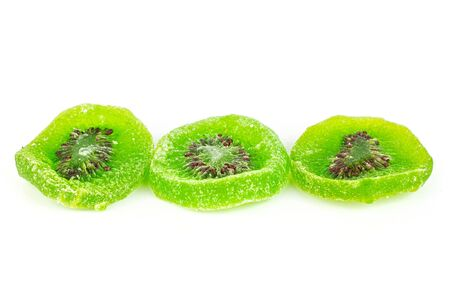 Group of three slices of sweet green candied kiwifruit isolated on white background