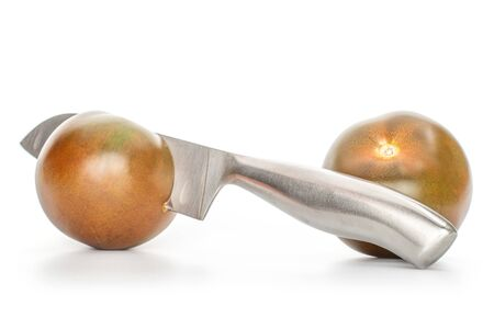 Group of two whole fresh green red tomato with santoku knife isolated on white background