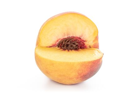 One whole cut fresh fuzzy peach isolated on white background Stok Fotoğraf