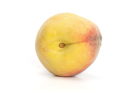 One whole fresh fuzzy peach with blush isolated on white background