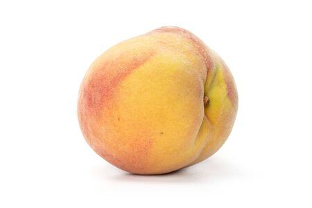 One whole fresh fuzzy peach isolated on white background