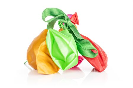 Lot of whole latex pastel ballon with green ribbon isolated on white background