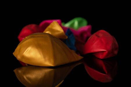 Lot of whole latex pastel ballon isolated on black glass
