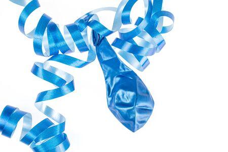 One whole latex pastel ballon with blue ribbon flatlay isolated on white background Stock Photo