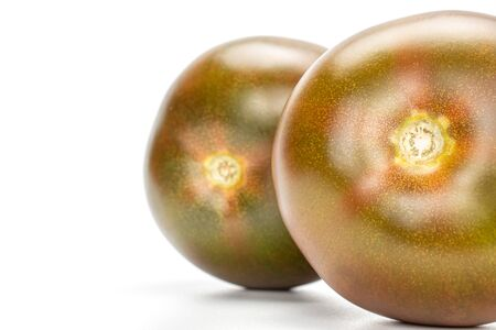 Group of two whole fresh green red tomato isolated on white background