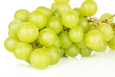Lot of whole fresh green grape cluster isolated on white background