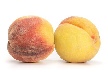 Group of two whole fresh fuzzy peach with blush isolated on white background Stok Fotoğraf
