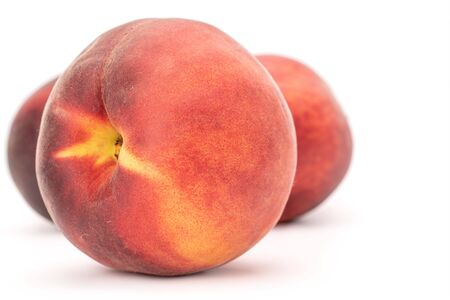 Closeup of one whole fresh fuzzy peach isolated on white background