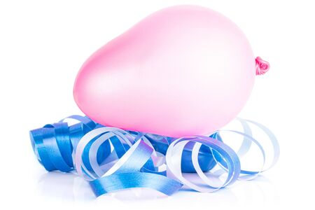 One whole inflated latex pastel ballon with blue ribbon isolated on white background