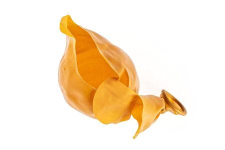 One whole orange latex pastel ballon flatlay isolated on white background