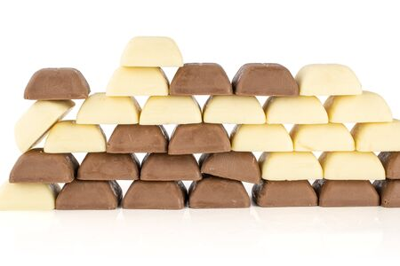 Lot of whole arranged fresh chocolate piece wall isolated on white background