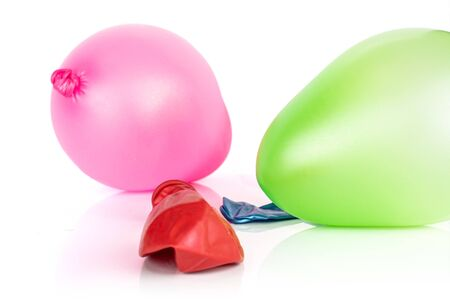 Group of three whole latex pastel ballon pink and green inflated isolated on white background