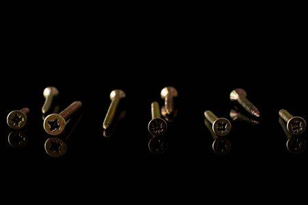 Group of nine whole metallic glossy bolt isolated on black glass Banco de Imagens - 131140593