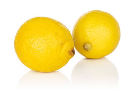 Group of two whole fresh yellow lemon isolated on white background