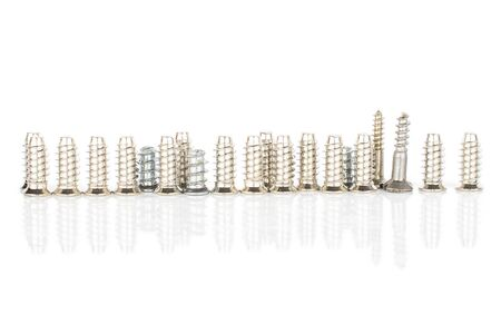 Lot of whole metallic glossy bolt in row isolated on white background