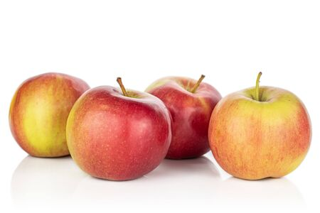 Group of four whole red apple jonagold isolated on white background