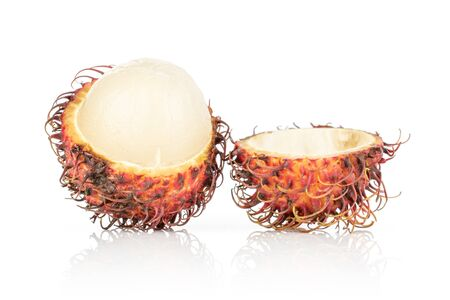 Group of two halves of fresh red rambutan isolated on white background Stock Photo