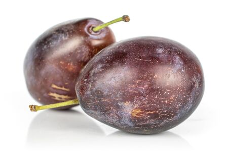 Group of two whole sweet purple plum isolated on white background Stock Photo