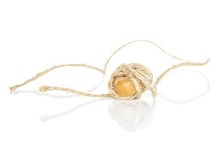 One whole caramel brown candy with jute rope isolated on white background Stock Photo - 131150845