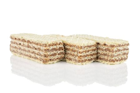 Group of three whole crispy beige hazelnut wafer cookie isolated on white background