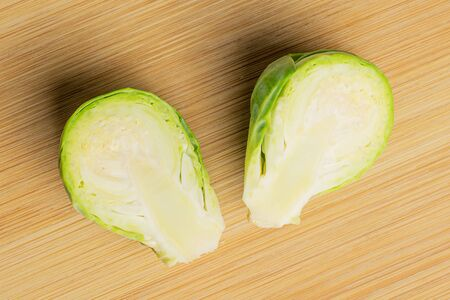 Group of two halves of fresh green brussels sprout flatlay on light wood 版權商用圖片