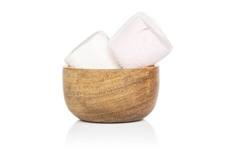 Group of two whole sweet pastel marshmallow in bamboo bowl isolated on white background