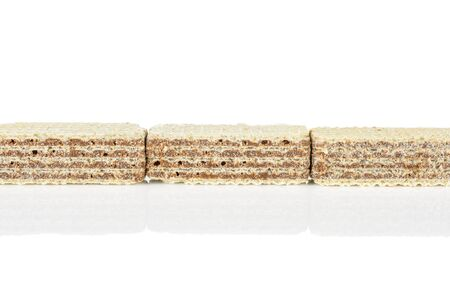Group of three whole crispy beige hazelnut wafer cookie in row isolated on white background 写真素材 - 131947409
